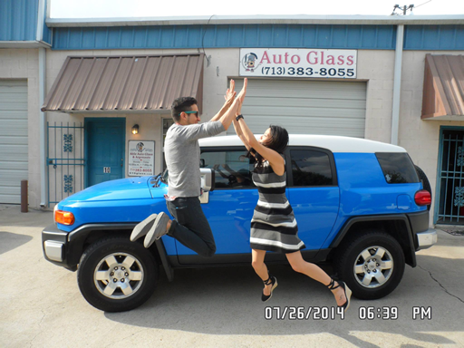 Photo of two of our clients jumping for joy at Able Auto Glass in Houston, TX