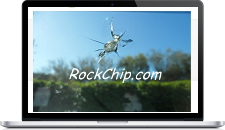 Picture of a large rock chip in a windshield that we were able to do a windshield repair.  This rock chip photo was frame onto a laptop screen.